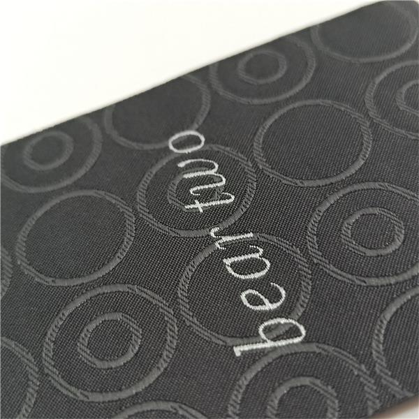 High density black tag ultrasonic cut labels for clothing